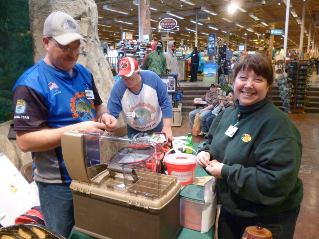 Robin Piedmonte, Special Events Coordinator at Bass Pro Shops of Auburn draws the winning tickets